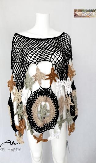 Шедьовър -ръчно плетено пончо.Това пончо е  продадено,но е в процес подобно